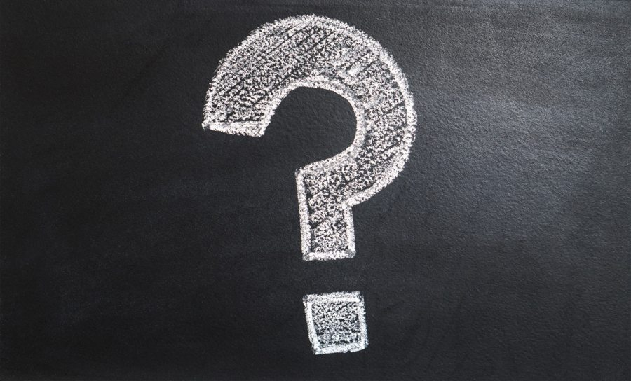 White question mark on a chalkboard