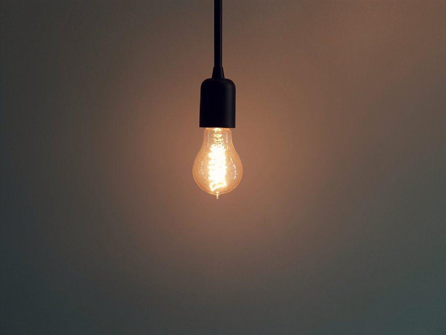 Lightbulb Illuminating Dark Room